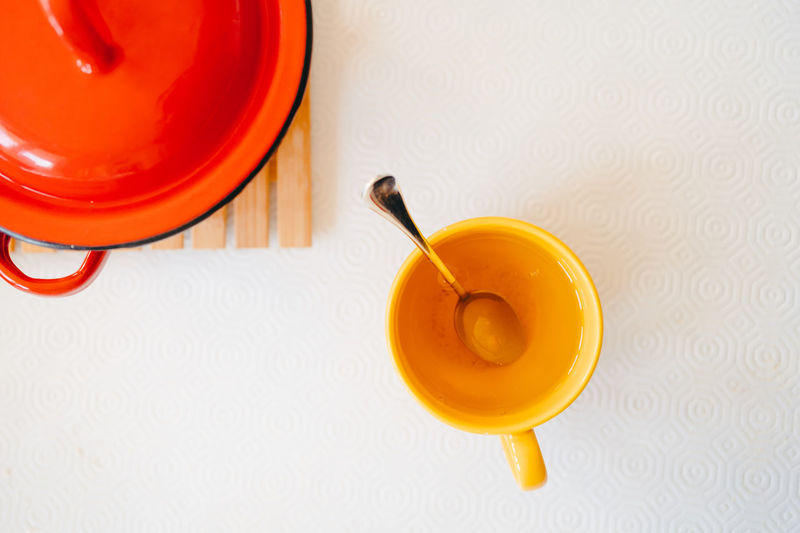 High angle view of yellow and drink on table