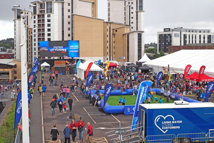 Newcastle upon Tyne on the Great North Run weekend 2017 Great North Run Newcastle Bridges Newcastle Upon Tyne River Tyne, Runners Adult Architecture Building Exterior Built Structure City Crowd Day Large Group Of People Lifestyles Lots Of People Men Outdoors People Real People Storm Clouds Text Women