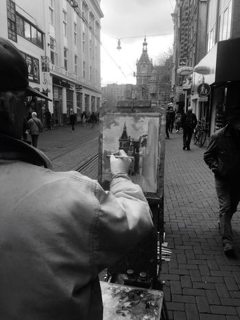 Your Amsterdam Blackandwhite Amsterdam Art People EyeEm Best Shots Blackandwhite Photography People Photography Life Urbanphotography Historical Building I took this photo on Leiseplein where painter Louis granted me permission to take this picture while telling me how he loves to go to crowded places bus being able to portrait tranquility on the canvas Leidseplein