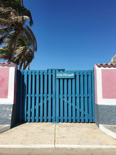 Wooden Door Colonial Style Colonial Architecture Colonial Outdoors Day Entrance No People Closed Building Exterior Door Built Structure Architecture Caribbean Blue Protection Sunlight Palm Tree Tree Clear Sky Nature Picket Fence Sky Beach Sommergefühle