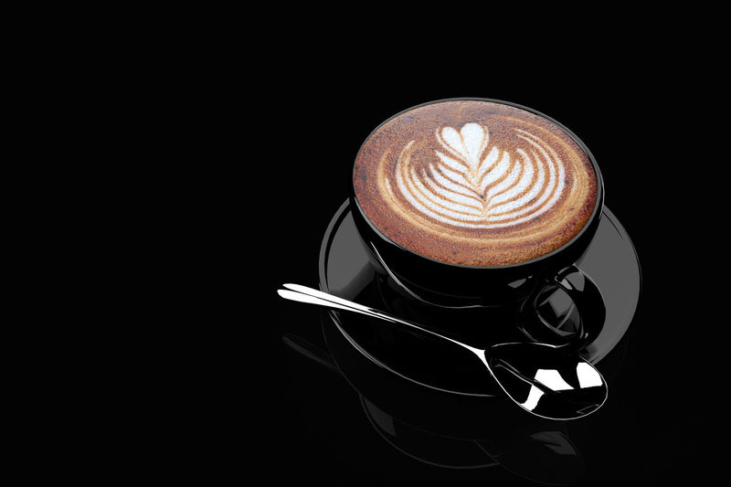 Coffee cup against black background