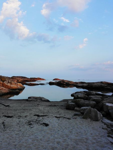 Water Sea Scenics Travel Destinations Tranquil Scene Sky Rock - Object Tranquility Tourism Travel Beauty In Nature Beach Vacations Non-urban Scene Stone - Object Cloud - Sky Nature Idyllic Geology Rock Formation First Eyeem Photo Reflection Beauty Horizon Over Water Seaside Breathing Space