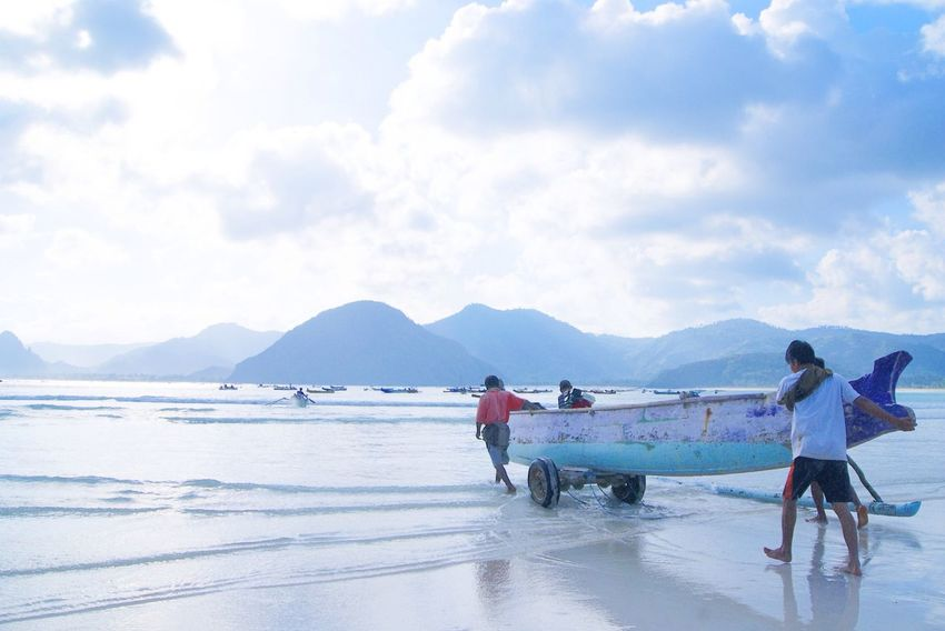 Sky Cloud - Sky Mountain Men Real People Occupation Scenics Transportation Sea Day Water Mountain Range Nature Working Two People Nautical Vessel Standing Outdoors Women Teamwork