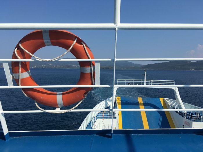 Framing the blues... Orange Life Vest Ferry Me Over EyeEm Selects Nautical Vessel Life Belt Water Boat Rope Transportation Mode Of Transport Safety Summer Exploratorium