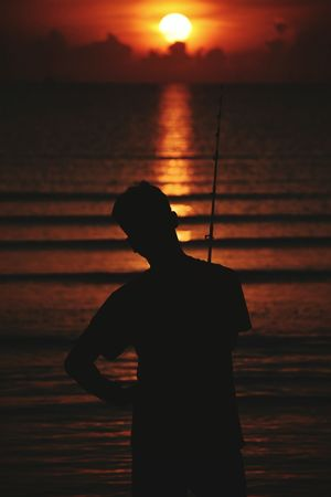 One Man Only Sunset Only Men Silhouette One Person Adult Waist Up Adults Only Mid Adult People Men Standing Outdoors Lifestyles Sae Water Sea One Young Man Only Nature Young Adult One Day Day Black Dark Hello World