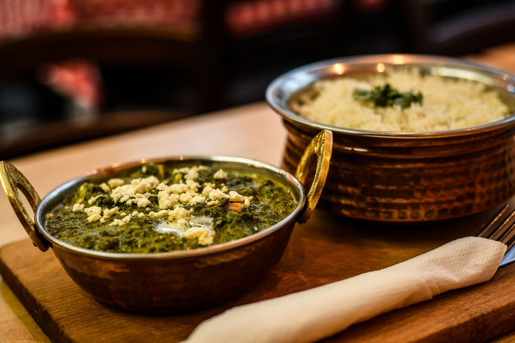 Palak Paneer; where taste meets tradition. Berlin Food Berlin Rohan Shetti Traditional Cooking Traditional Culture Culinary Arts North Indian Food Paneer Spinach Healthy Food Spicy Indian Food At Its Best Vegetarian Food Palak Paneer Indian Food In Berlin Container Focus On Foreground Vegetable Herb Kitchen Utensil Serving Size Selective Focus No People Wood - Material Close-up Healthy Eating Wellbeing Still Life Ready-to-eat Indoors  Bowl Freshness Table Food And Drink Food Food Portfolio Food Photography The Foodie - 2019 EyeEm Awards