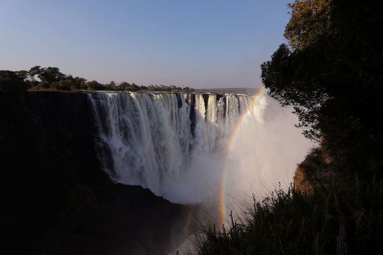 Water Scenics - Nature Tree Beauty In Nature Motion Waterfall Long Exposure Power In Nature Sky Flowing Water Nature Clear Sky Environment Flowing Outdoors Victoria Falls Zimbabwe Victoriafalls Nature Nature_collection Nature Photography