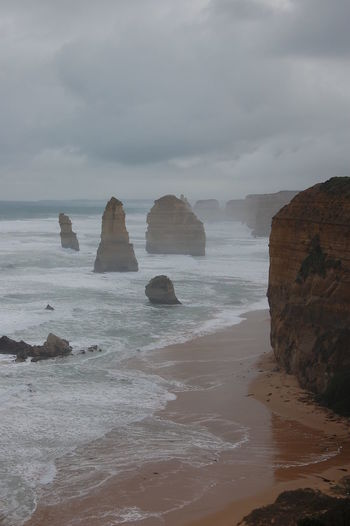 Water Rock Sea Solid Rock - Object Sky Beauty In Nature Beach Land Scenics - Nature Rock Formation Tranquility Tranquil Scene Nature Cloud - Sky Motion No People Day Idyllic Stack Rock Outdoors Horizon Over Water Eroded Sea Mist Stormy Sea 12 Apostles Australia