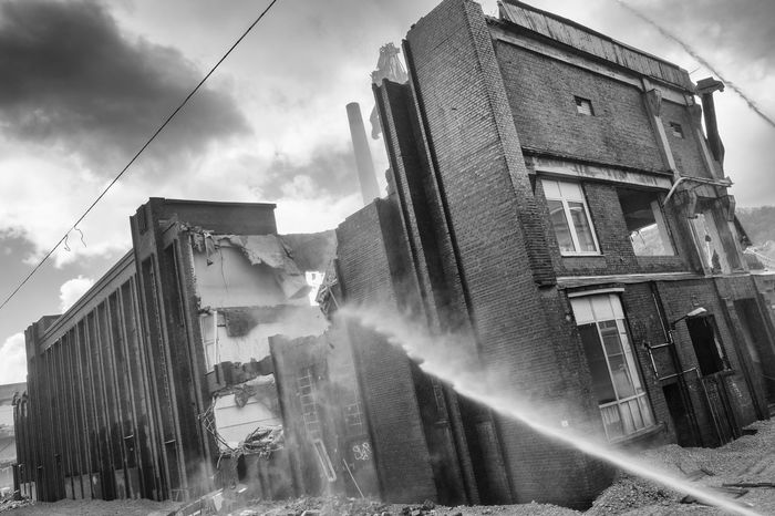 Demolition. black and white Brick Wall Industry Abandoned Architecture Black And White Building Exterior Built Structure Damaged Day Destruction Extinguish Monochrome No People Old Outdoors Sky Stone Street Urban Water