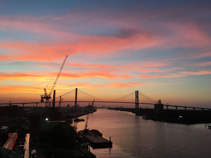 Sunsets in Savannah Savannah Suspension Bridge River River View Sunset Sky Water Dramatic Sky No People Crane - Construction Machinery Bridge - Man Made Structure