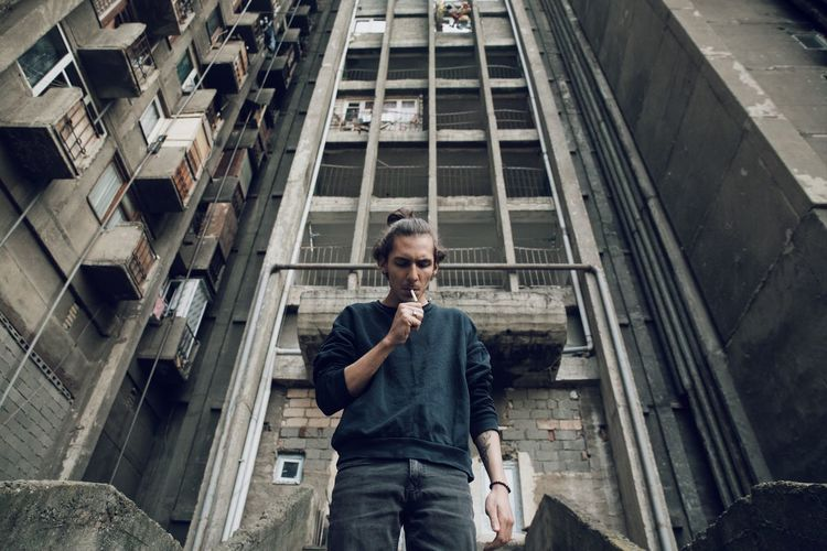 Low angle view of man standing in front of building