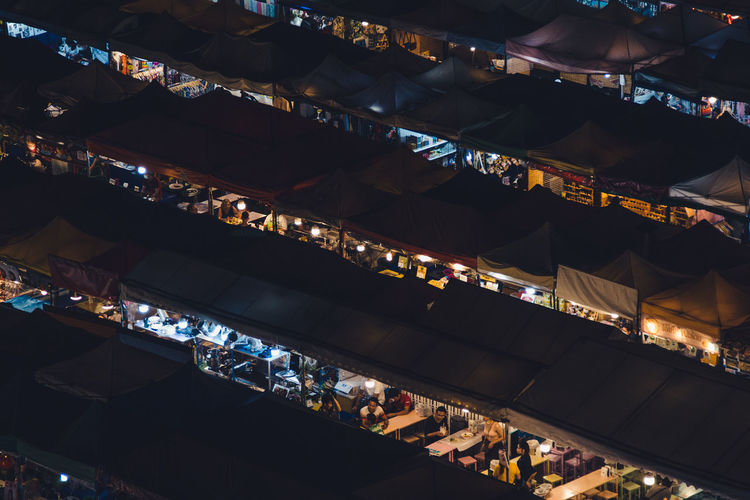 High angle view of illuminated market at night