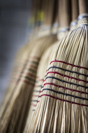 Handmade millet broom. Arrangement Australia Broom Broomstick Close-up Extreme Close Up Group Of Objects Handmade Hanging In A Row Large Group Of Objects Medium Group Of Objects Millet Multi Colored No People Order Selective Focus String Surface Level Variation