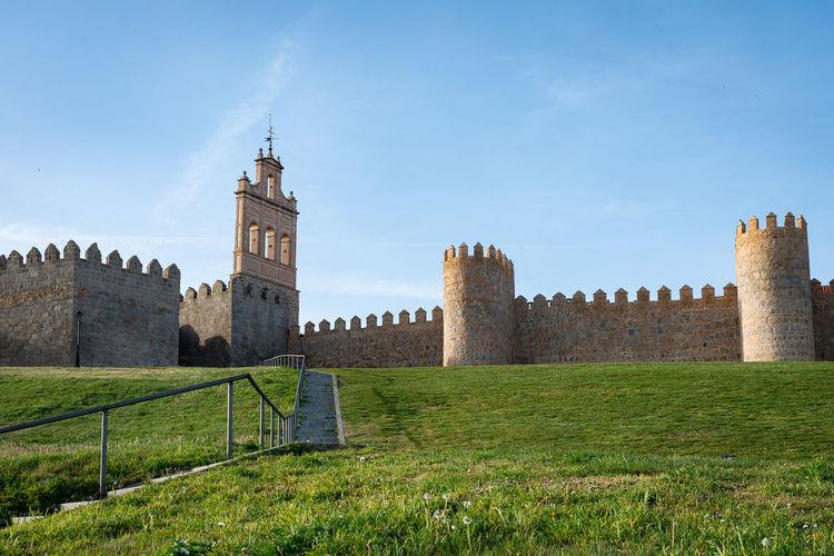Ancient city walls in the old city of Avila, Spain Avila, Spain Architecture Built Structure History The Past Sky Building Exterior Grass Plant Building Tower Travel Destinations Fort Castle Travel Land Wall Castilla Y León Grass No People Outdoors Day Tourism