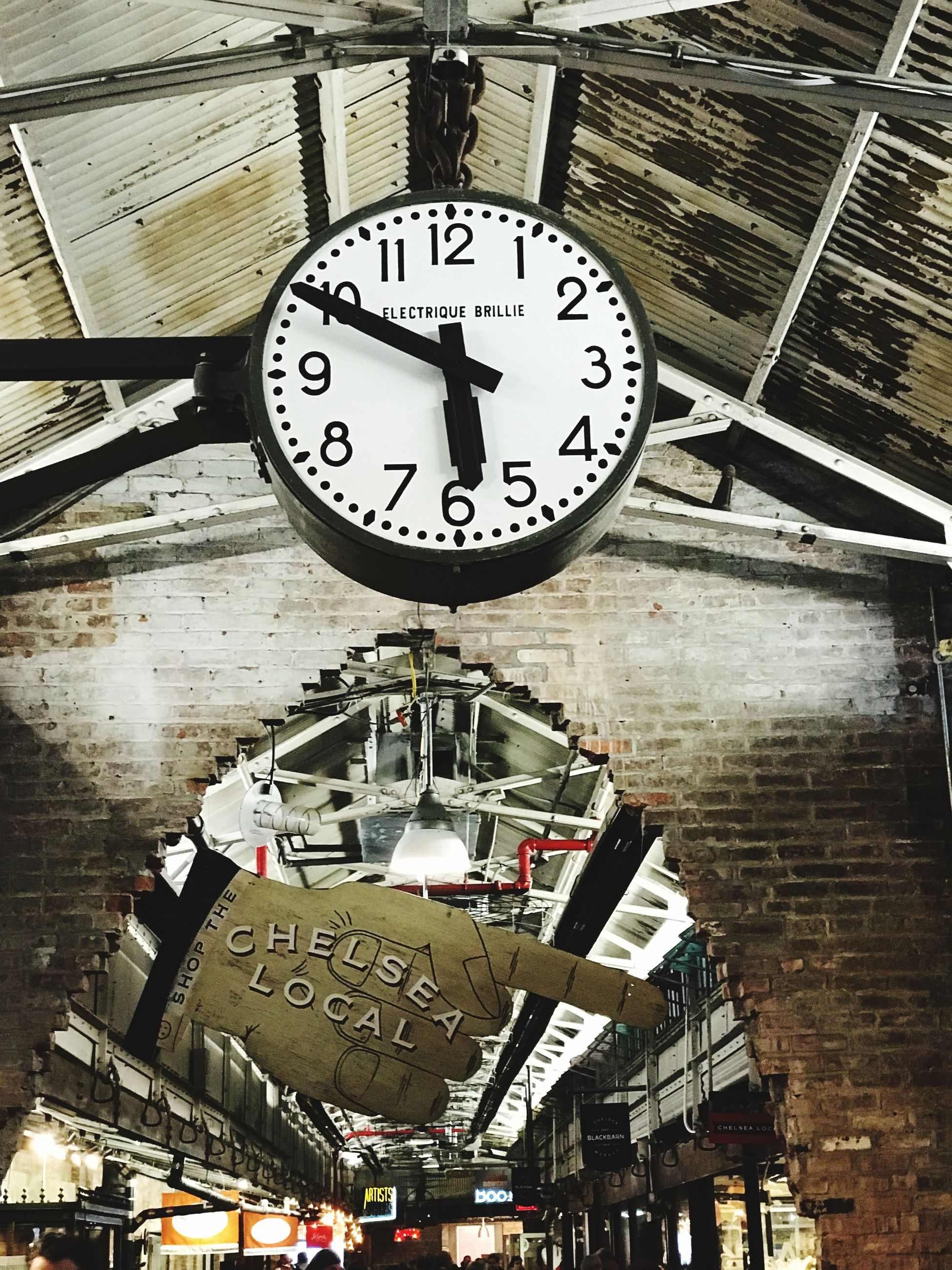 clock, time, number, low angle view, architecture, text, communication, built structure, no people, hanging, instrument of time, western script, accuracy, minute hand, building exterior, sign, railroad station, day, wood - material, clock face, ceiling, station