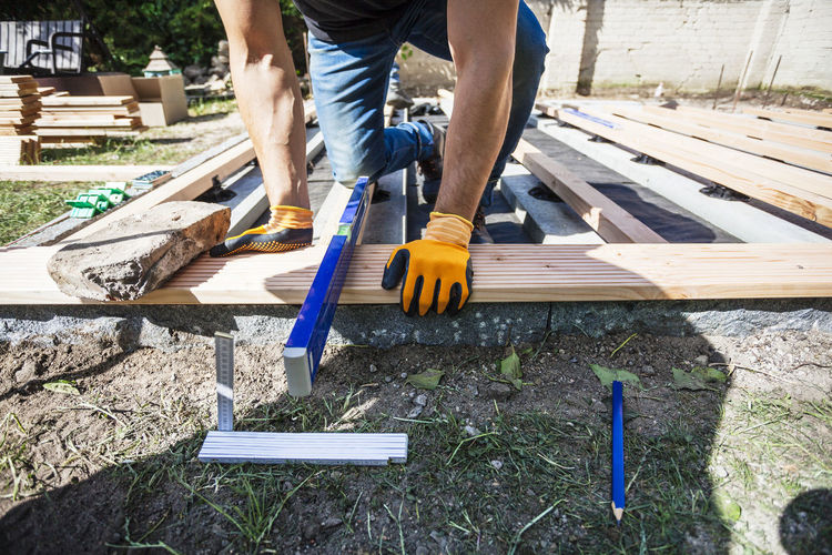 Construction Construction Site DIY Do It Yourself Home Improvement Measuring Working Accuracy Building Building Site Carpenter Construction Work Construction Worker Craft Garden Handmade Level Measure Occupation One Person Precision Project Real People Tools Wood - Material