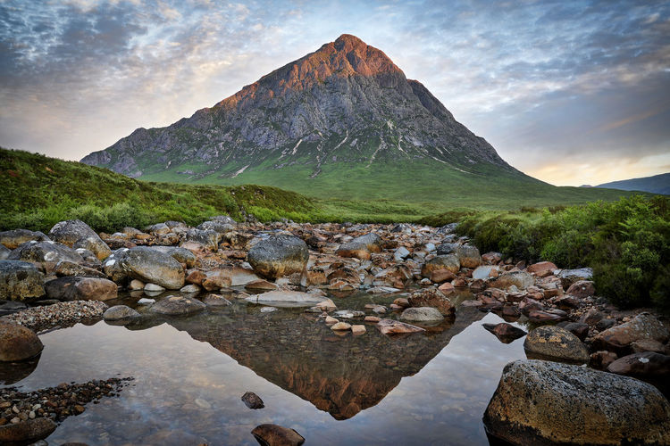 Sunrise at Buachaille Etive Mòr, Glencoe, Scotland. Britain Glencoe Scotland Beauty In Nature Buachaille Etive Mor Cloud - Sky Landscape Mountain Mountain Peak Mountain Range Nature Reflection Rock Scenics - Nature Sky Sunrise Tranquil Scene Tranquility