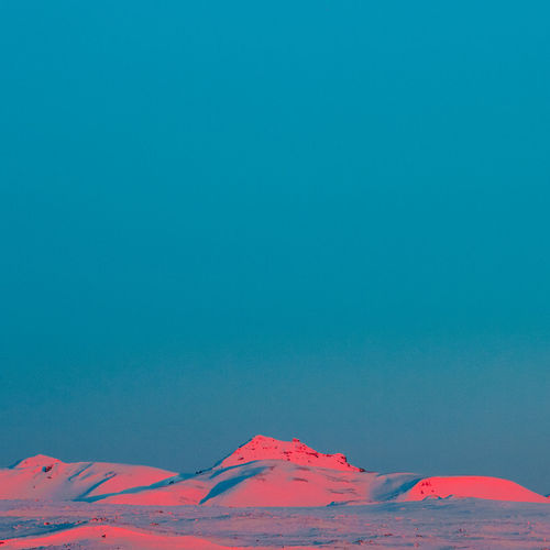 Idyllic Shot Of Snowcapped Mountains Against Clear Blue Sky