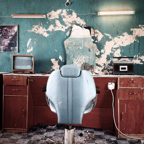 Empty Barber Chair In Abandoned Salon