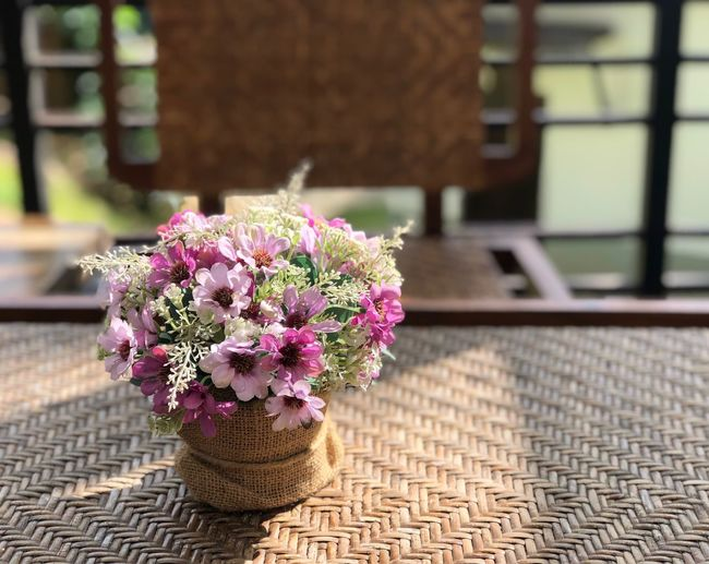 Beautiful sunshine with flowers on the table in the garden Flora Sunshine Beautiful Flowers Relex Flower Flowering Plant Plant Nature Fragility Freshness Architecture Beauty In Nature Sunlight Outdoors No People Day Close-up First Eyeem Photo EyeEmNewHere