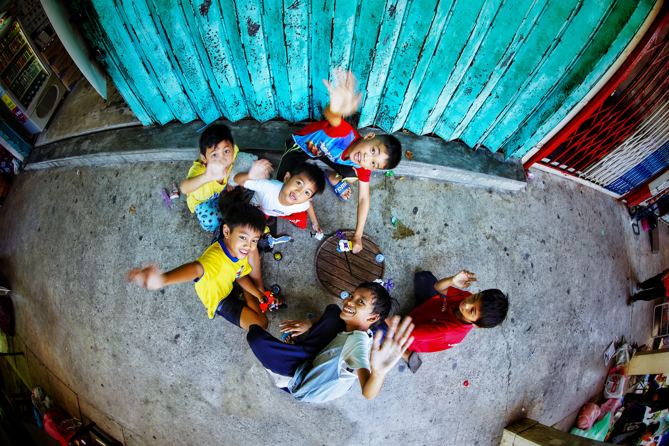 group of people, high angle view, men, males, women, adult, togetherness, child, group, portrait, boys, real people, girls, people, females, young adult, childhood, looking at camera, medium group of people, indoors