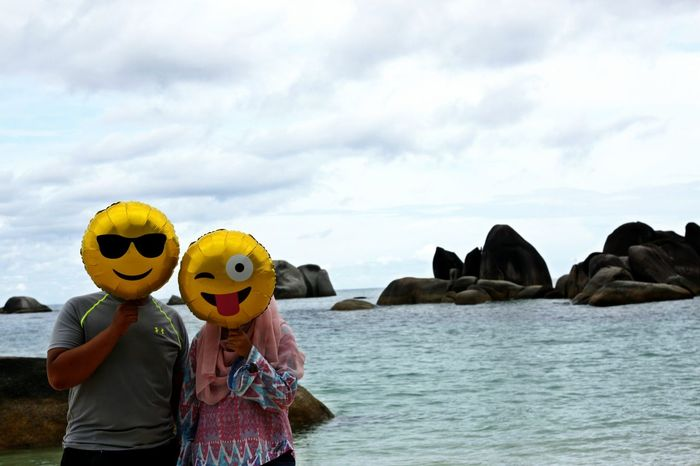 Adult Anthropomorphic Anthropomorphic Face Anthropomorphic Smiley Face Beach Cloud - Sky Day Emoticon Emoticons Happy Vacation  Men Nature Outdoors People Real People Sea Sky Smiley Emoticon Togetherness Two People Water