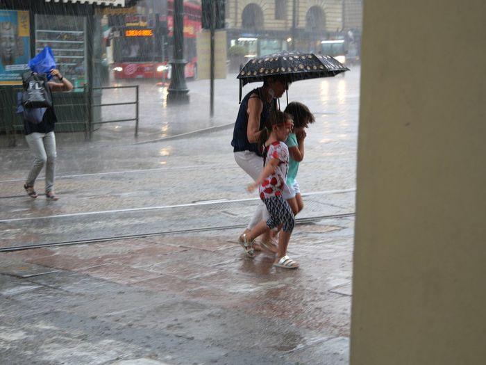 People walking on wet street in rain