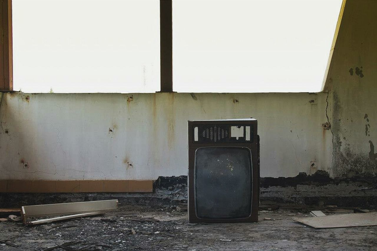 Abandoned television set in house