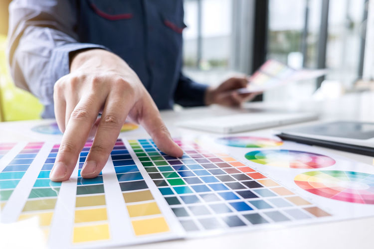 Architecture Business Close-up Color Chart Colorful Connection Creativity Day Design Professional Finger Focus On Foreground Graphic Design Hand Human Body Part Human Hand Indoors  Multi Colored One Person Pantone Screen Selective Focus Swatch Table Technology Touch Screen
