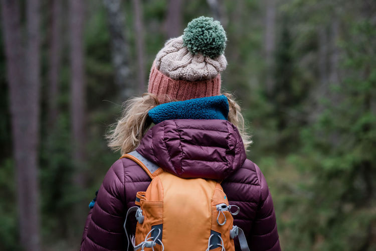 Rear view of woman wearing hat in forest