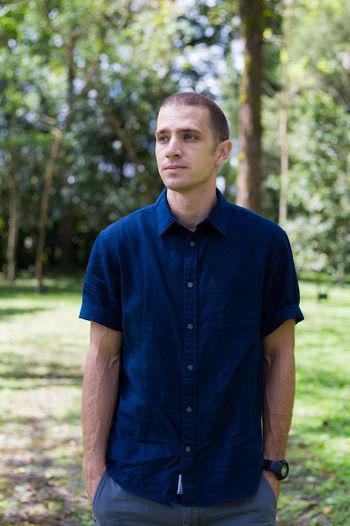 Portrait of man standing on grass