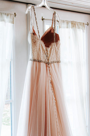 Close-up of clothes hanging on white window
