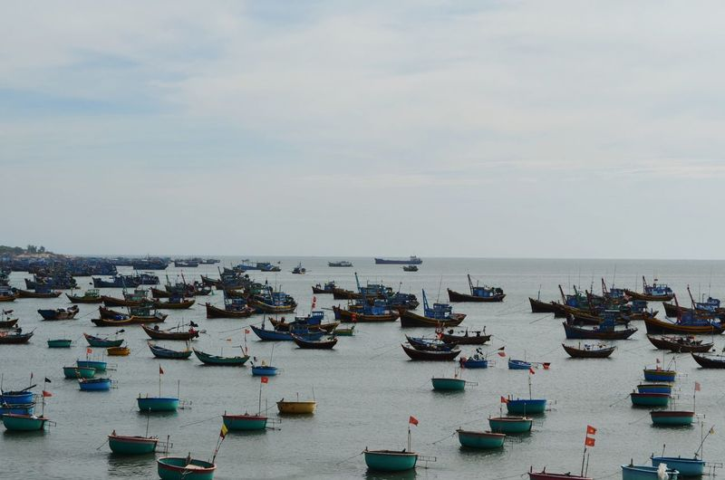 High Angle View Of Boats Moored In Sea Against Sky
