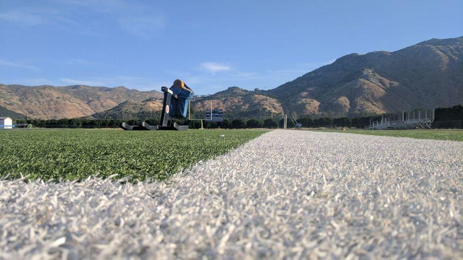 Soccer field against blue sky