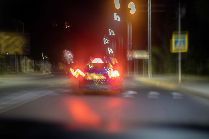 Illuminated car on road at night
