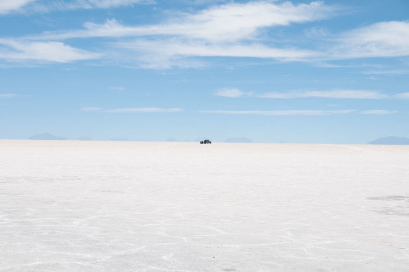 Salar de Uyuni is the world's largest salt flat. It's the legacy of a prehistoric lake that went dry, leaving behind a desertlike, nearly 11,000-sq.-km. landscape of bright-white salt, rock formations and cacti-studded islands. Bolivia Clear Sky Desrt Scenes Extreme Terrain Flat Horizon Jump Outdoors Salar De Uyuni Salt - Mineral Sand South America Travel Travel Destinations Travel Photography
