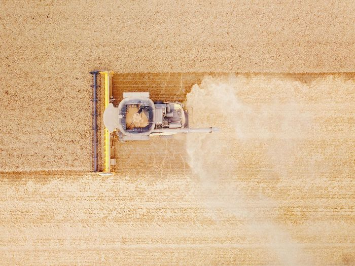 Directly above shot of machinery on agriculture field