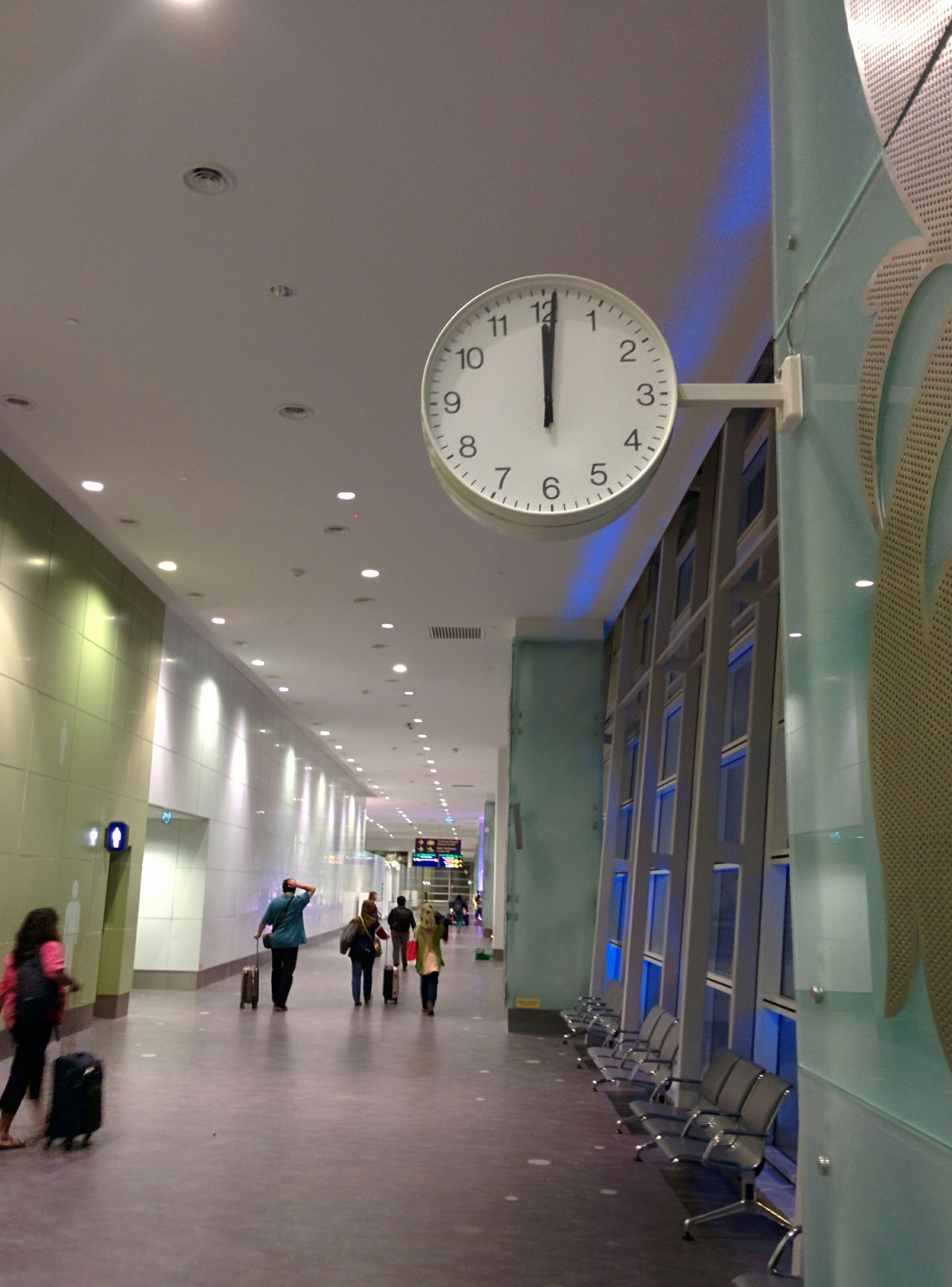 indoors, architecture, ceiling, men, built structure, person, illuminated, lifestyles, large group of people, leisure activity, lighting equipment, clock, flooring, modern, corridor, walking, travel, hanging, shopping mall