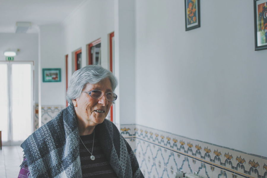 EyeEm Selects Standing Gray Hair Adult People Day Indoors  One Person Senior Adult Connection Adults Only Portrait Of A Woman Portrait Woman Who Inspire You Woman Beautiful Lovely People Nursing Home Helping Others Smiling Happy Seniors This Is Natural Beauty