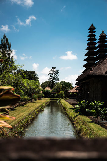 Bali Bali, Indonesia Worship Hinduism Religion Temple Plant Sky Tree Water Architecture Nature Cloud - Sky Built Structure No People Tranquility Growth Day Tranquil Scene Beauty In Nature Outdoors Direction Building Exterior Green Color Scenics - Nature Canal
