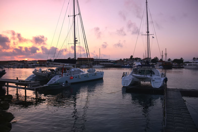 Marina at sunset Marina, Sunset Marina Beauty In Nature Boat Cloud - Sky Day Harbor Mast Mode Of Transport Moored Nature Nautical Vessel No People Outdoors Reflection Sailboat Scenics Sea Sky Sunset Tranquility Transportation Water Waterfront Yacht