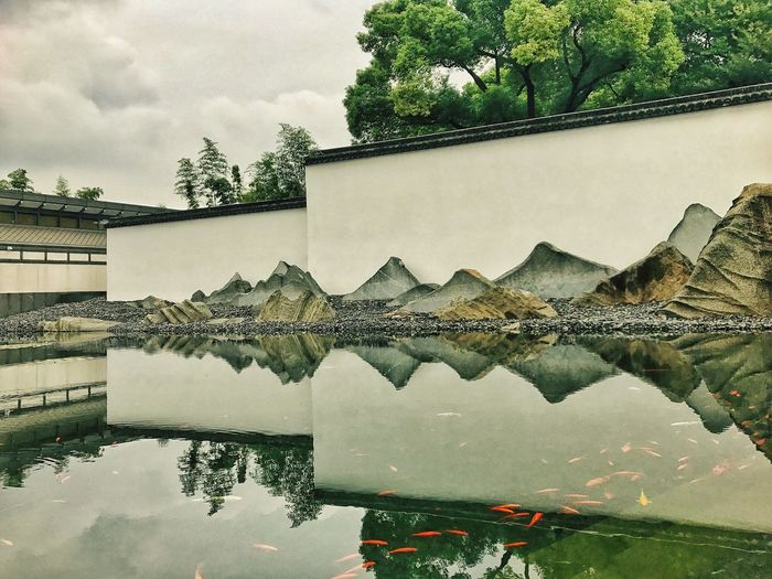 Suzhou Museum. Reflection Water Architecture Building Exterior Built Structure Day Outdoors Sky Tree No People Nature Growth Beauty In Nature Puddle