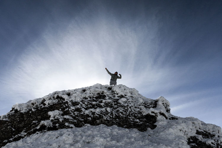 Low angle view of a person in snow