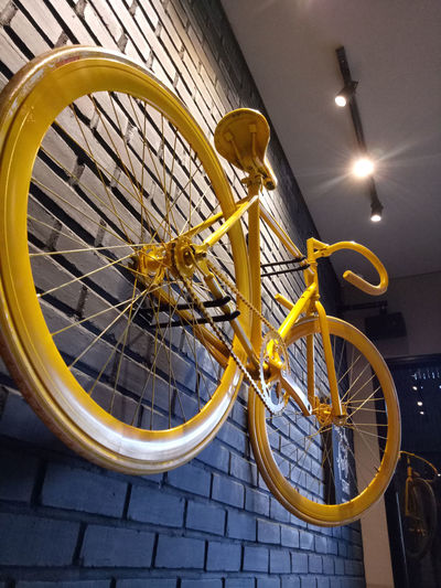 Black brickwall with Yellow bicycle feature, a nice corner in warunk Upnormal Wall Art Wall Brick Wall Yellow Black Cafe Wall Feature Background Bicycle Bicycle Rack Wheel No People Interior Restaurant Restaurant Decor Decoration Decor Unique Unique Art
