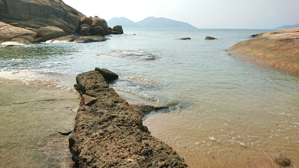 Sea Beach Outdoors Water Day Nature Beauty In Nature Sky Landscape Formation Of Nature Rocks Hong Kong Cheung Chau Beauty In Nature Nature No People Cloud - SkyAdult Human Body Part One Man Only