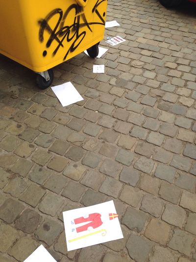 Street Streetphotography Saint Nicolas Drawings Garbage Falling Text Day Communication Outdoors Yellow No People Road Sign