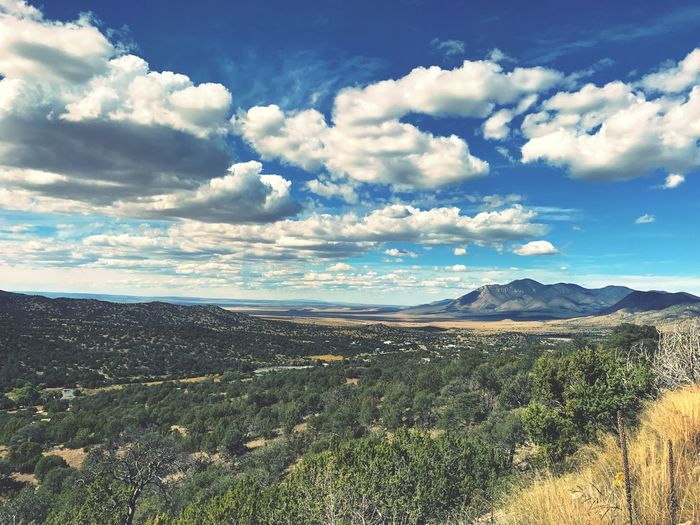 """The Valley of The Sun"" (Valle del Sol) And I beheld the kingdom and the keys were the road, the clouds the magic carpet of my imagination, guiding me like a travel log, beyond the visible horizon, and it was good. Tranquil Scene Landscape Mountain Scenics Sky Mountain Range Valley Travel Travel Photography Exploring Newmexico Newmexicophotography Newmexicoskies"