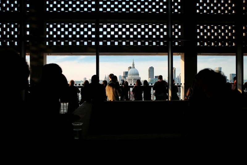 Silhouette of people in office building