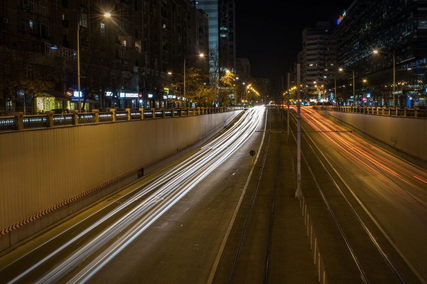 Night Illuminated City Motion Light Trail Transportation Speed Street Light Traffic Long Exposure Street City Street Road Cityscape Vehicle Light City Life Travel Destinations Bridge - Man Made Structure Outdoors Architecture No People Built Structure Architecture