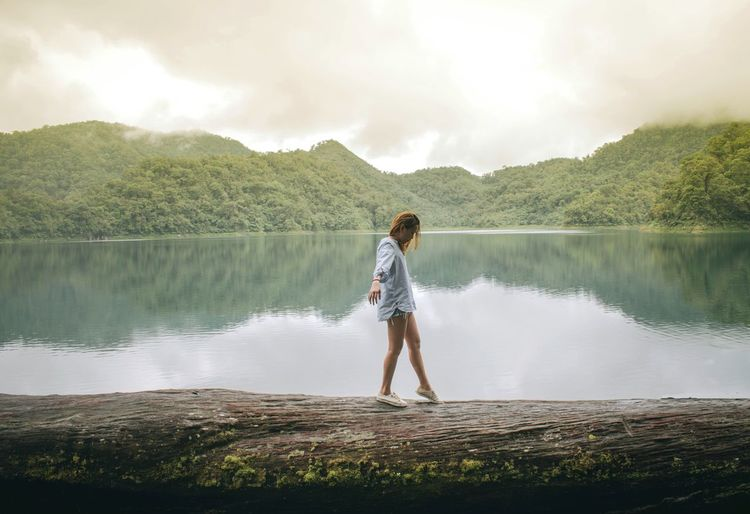 Girl in the lake Lake One Person Reflection Nature Water Adult One Man Only People Standing Outdoors Cloud - Sky Leisure Activity Sunlight Tranquility Day Mountain Philippines ASIA Earth Travel Tourism Explore Adventure First Eyeem Photo EyeEmNewHere 100 Days Of Summer Famous Place Looking At View Hiking Tourist Attraction